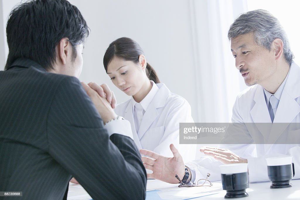 Doctors And Pharmaceutical Rep Taking At Table Stock Photo Getty
