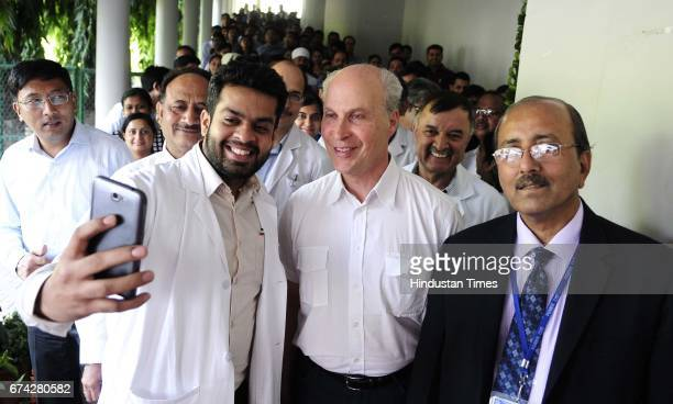Doctors and students taking selfie with Nobel laureate Prof Roger D Kornberg Department of Structural Biology Stanford School of Medicine USA and PGI...