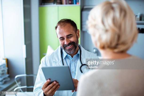 doctor's appointment - general practitioner stock pictures, royalty-free photos & images