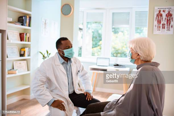 doctors appointment - protective face mask stock pictures, royalty-free photos & images