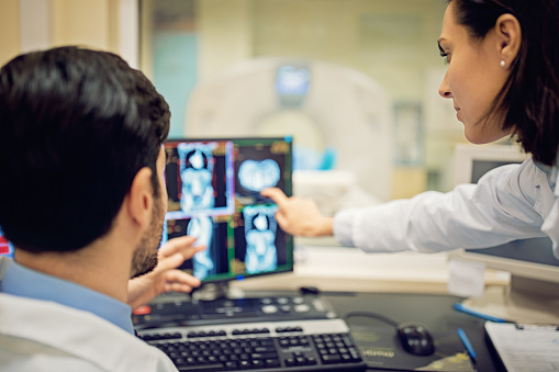 Doctors are working with CT scan in hospital 1124543330