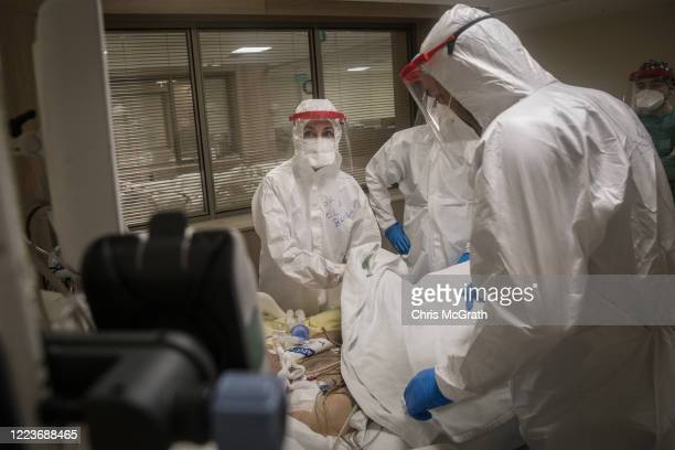 Doctors assist a COVID-19 patient at the Kartal Dr. Lutii Kirdar Education and Research Hospital, Intensive Care Unit on May 08, 2020 in Istanbul,...