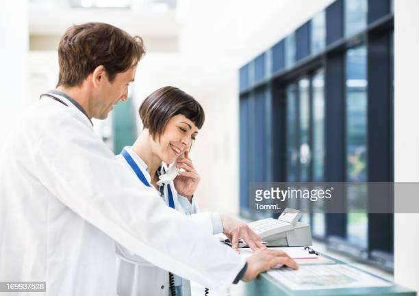 Doctors at Reception Desk