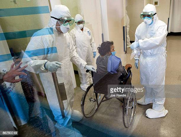 Doctors at the Mexico City Navy Hospital wear protective gear as they tend to a patient complaining of a flulike symptoms on April 29 2009 in Mexico...