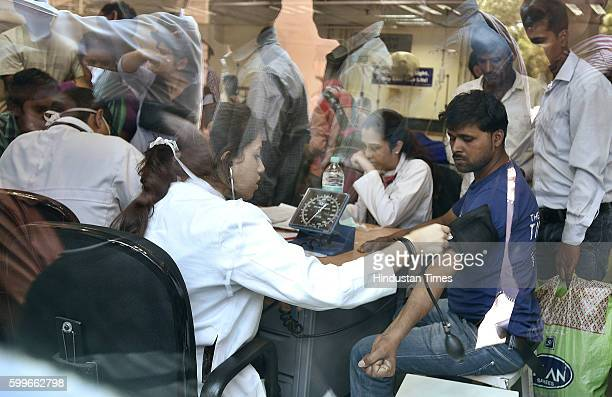Doctors attending patients at a dengue fever emergency clinic at Ram Manohar Lal Hospital on September 6 2016 in New Delhi India Delhi continues to...