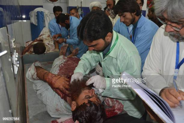 QUETTA BALOCHISTAN PAKISTAN Doctors attending to a victim of a suicide bombing attack on a Balochistan Awami Party corner meeting at Mastang district...