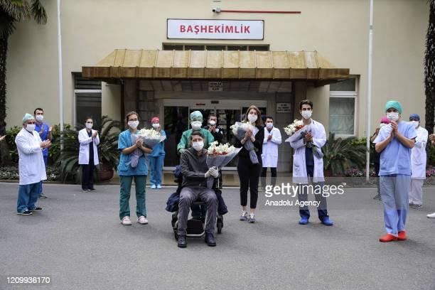 Doctors Birol Balcin Recep Kaya Burcu Sari and nurse Gamze Fincan are being discharged from the hospital accompanied by applauds in the organized...