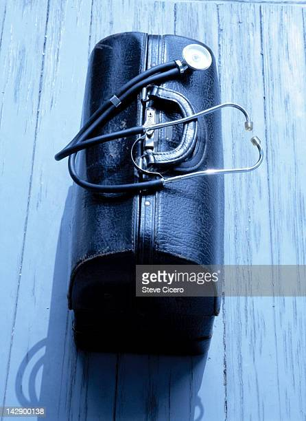 Doctors carry bag with stethoscope on porch
