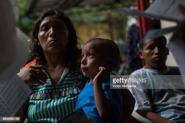 Doctors Catholic Charities NGO are hand to examine patients and to distribute medicine to Warao Indians on May 16 2017 in Manaus The economic crisis...