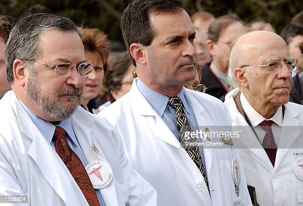 Doctors Charles Moss Joel Levine and Abbey Parangi listen to a speaker during a brief rally protesting skyrocketing malpractice insurance fees at the...