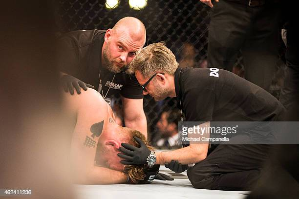 UFC doctors check on Alexander Gustafsson of Sweden after his knockout defeat to Anthony Johnson of the United States during the UFC Fight Night...