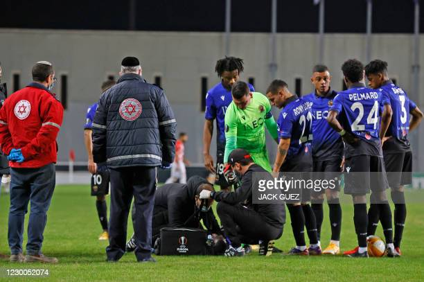 Doctors check on Nice's defender Racine Coly during the UEFA Europa League group C football match between Hapoel Beer-Sheva and Nice at the Hamoshava...