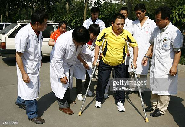 Doctors check the artificial legs of Chinese man Peng Shuilin whose body was severed in half in a traffic accident before he leaves the China...