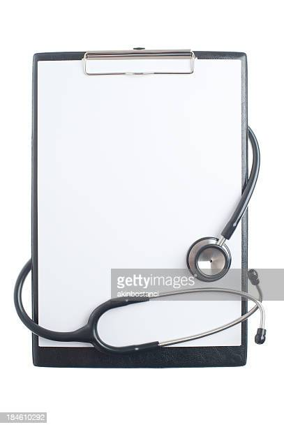 Doctors clipboard and stethoscope on white background