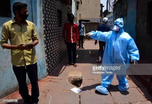 Doctors conducting COVID 19 screening test at Matunga Labour Camp, following COVID 19 pandemic at Dharavi, on April 18, 2020 in Mumbai, India.
