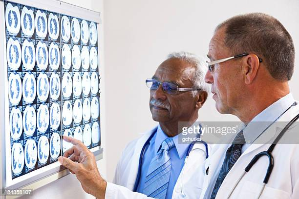 Doctors Consulting On X-Ray