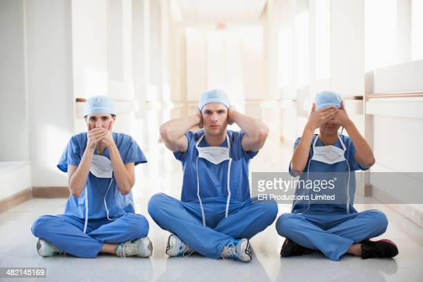 Doctors covering mouth, ears and eyes in hospital