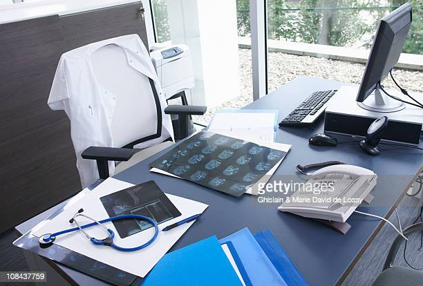 Doctor's desk, x-rays & stethoscope