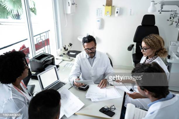 doctors discusses something during doctor's conference / meeting - debate stock pictures, royalty-free photos & images