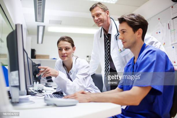 doctors during computer tomography exam - hospital machine stock photos and pictures