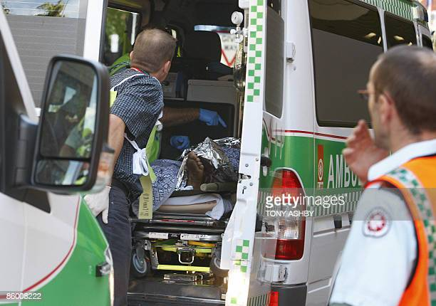Doctors examine an Afghan asylum seeker suffering burns on arrival by ambulance at the emergency section of Royal Perth Hospital in Perth on April 17...