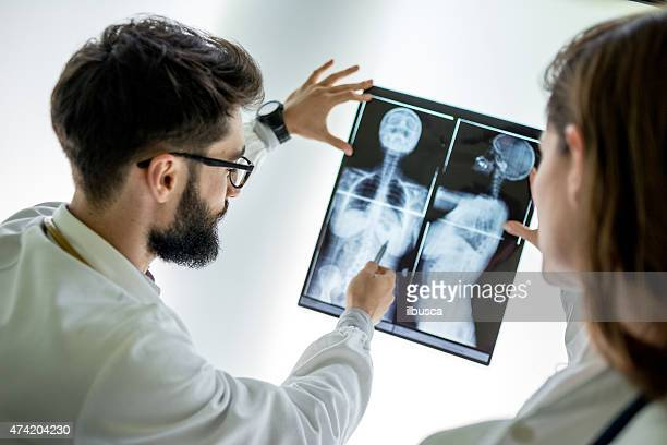 doctors examining x-ray - breast stock pictures, royalty-free photos & images