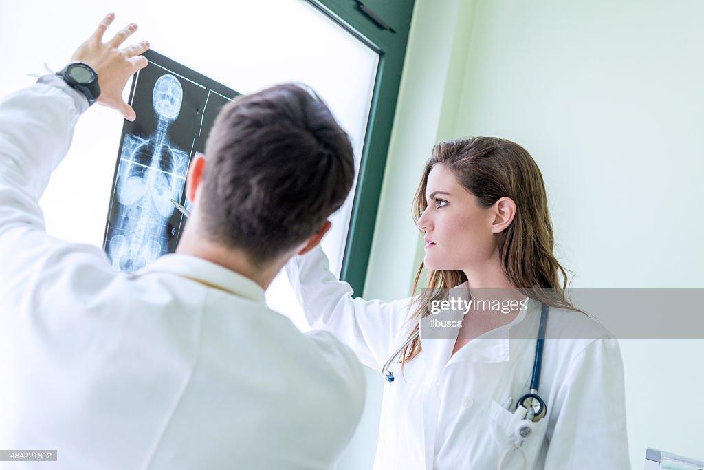Doctors examining x-ray : Stock Photo