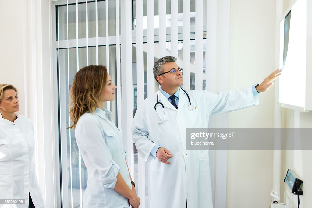 Doctors examining x-ray : Stock Photo