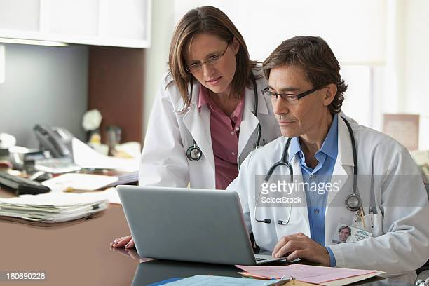 Doctors going over records in office