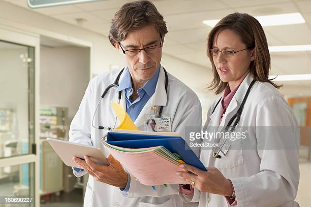 Doctors going over records