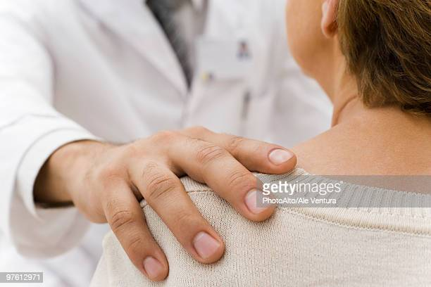 doctor's hand on patient's shoulder - hand on shoulder stock pictures, royalty-free photos & images