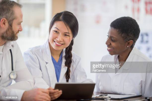 doctors having a discussion - civilian stock pictures, royalty-free photos & images