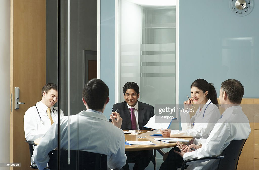 Doctors having a meeting : Stock Photo