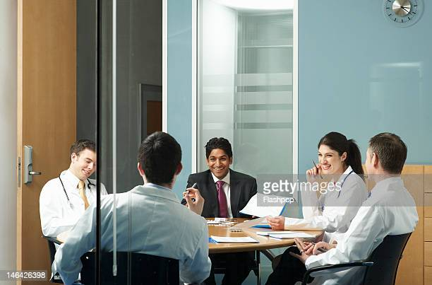 doctors having a meeting - healthcare stock pictures, royalty-free photos & images