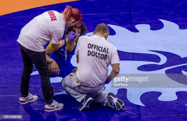 Doctors help Egypts Hassan Hassan Ahmed Mohamed during the final of mens Greco Roman 63 kg category at the World Wrestling Championships in Budapest...