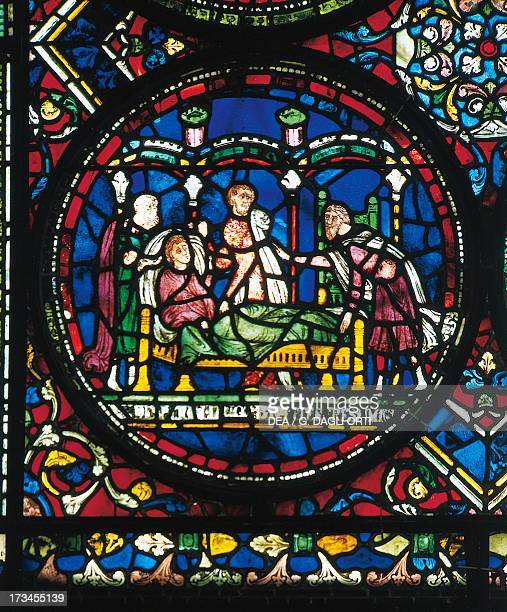 Doctors in consultation around a sick person , glass, Canterbury Cathedral , England, United Kingdom.