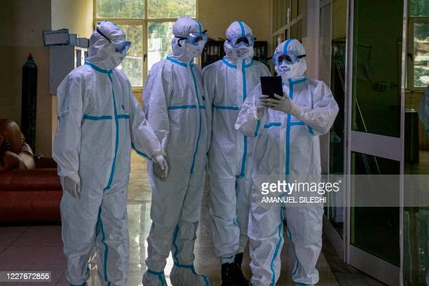 Doctors in personal protective equipment finish their 6-hour duty to treat patients who are infected with the COVID-19 coronavirus in the intensive...