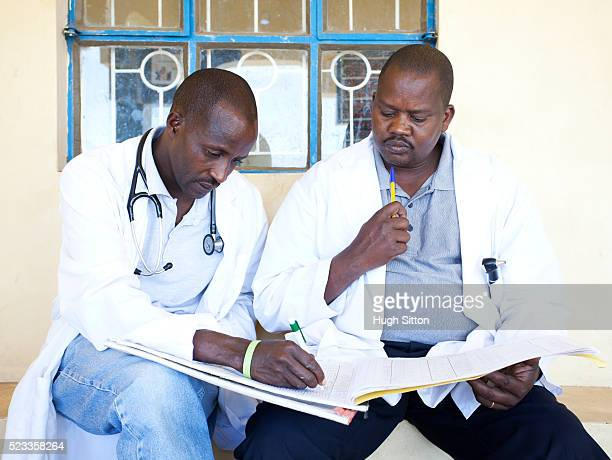 doctors in village hospital - hugh sitton stock pictures, royalty-free photos & images