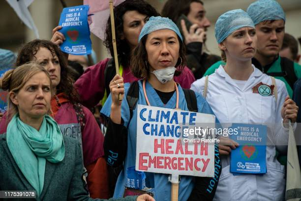 Doctors join Extinction Rebellion activists continue to demonstrate for the sixth day running in Trafalgar Square on October 12 2019 in London...