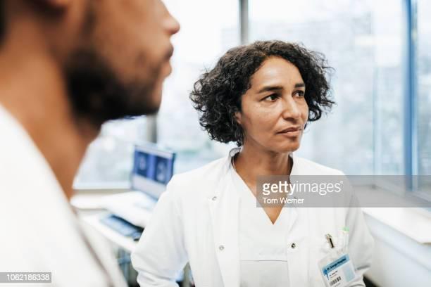 Doctors Listening During Seminar