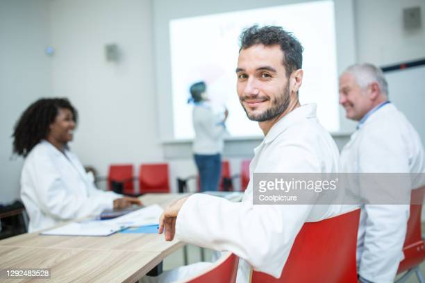 doctors listening to a speech. - attending stock pictures, royalty-free photos & images