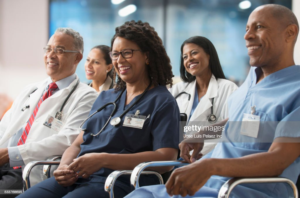 Doctors listening to presentation at conference : Foto stock