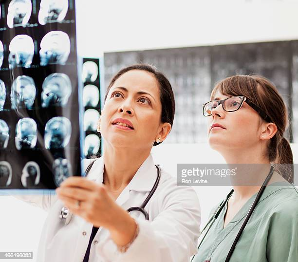Doctors looking at mri x-rays in clinic