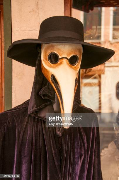Doctor's mask with long beak for plague time and velvet Bauta cloack Venice Italy