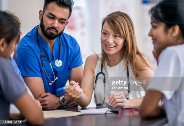 doctor's meeting - civilian stock pictures, royalty-free photos & images