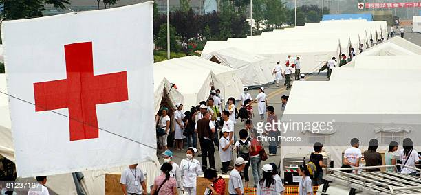 Doctors move an injured earthquake survivor into the field hospital newly built by German Red Cross for China's earthquake victims on May 26, 2008 in...