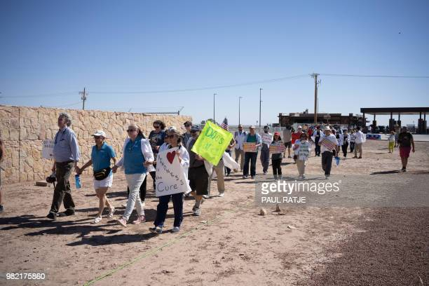 Doctors, nurses and medical students march to the entrance of the Tornillo Port of Entry in Tornillo, Texas, to demand an end to separation of...