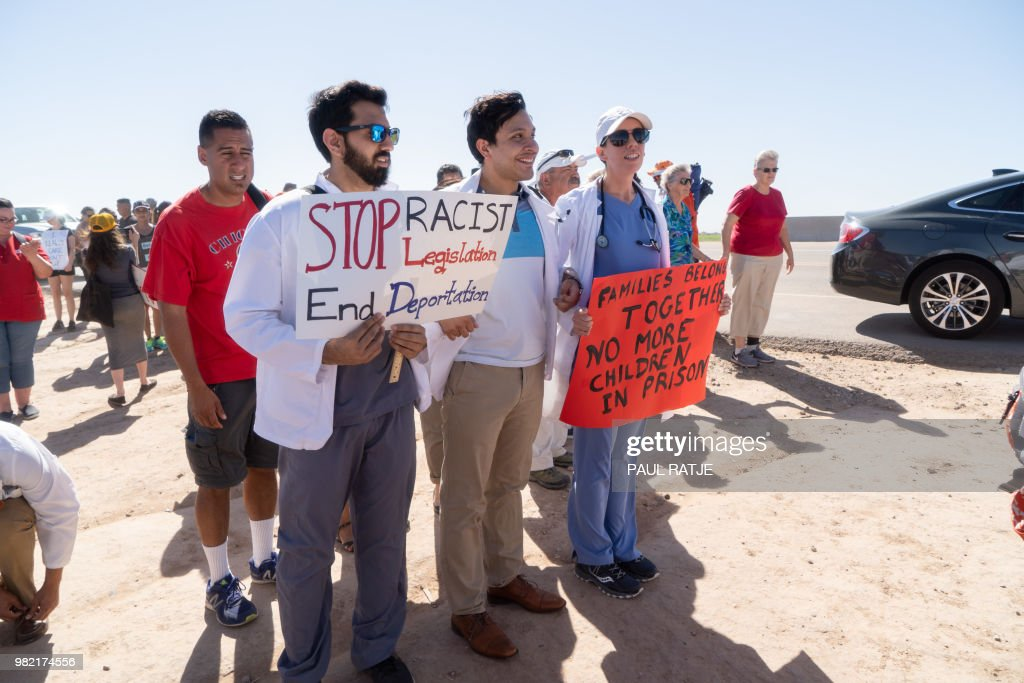 Doctors, nurses and medical students march to the Tornillo Port of Entry on June 23, 2018 in Tornillo, Texas, to demand an end to separation of immigrant children from their parents. - The Trump administration's erecting of a tent city to house minors separated from their parents has drawn sharp criticism, and is still under fire, despite President Trump's executive order to stop family separation.