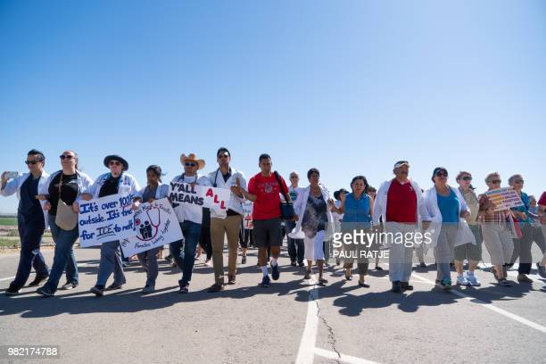 Doctors, nurses and medical students march to the Tornillo Port of Entry on June 23, 2018 in Tornillo, Texas, to demand an end to separation of...