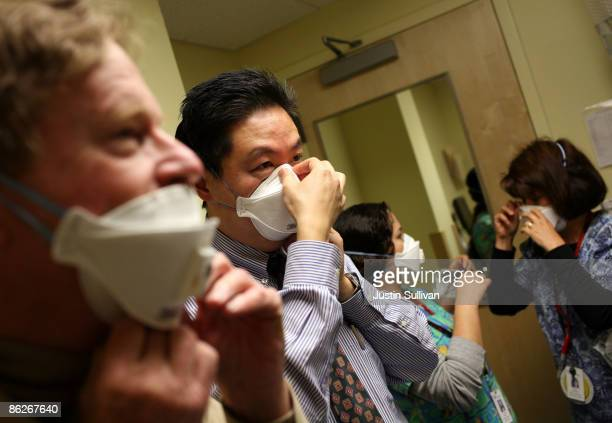 Doctors, nurses and staff members at the La Clinica San Antonio Neighborhood Health Center are shown how to use the N95 respiratory mask April 28,...